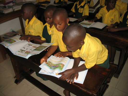 Four Students Looking Closely at Colourful New Textbooks