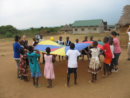 EWCV Children and Canadian Volunteers Playing with a Parachute