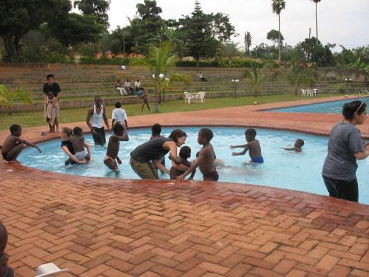 EWCV Children, Volunteers and Staff Having Fun in Masaka Pool