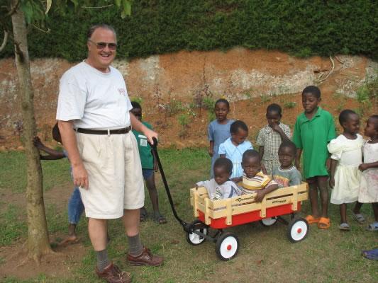 Ja Ja Bill Pulling Three Boys in Donated Wagon