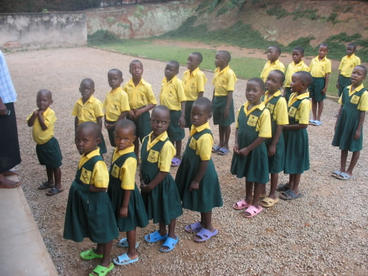 Beth Pipe School Students in their Green and Yellow Uniforms