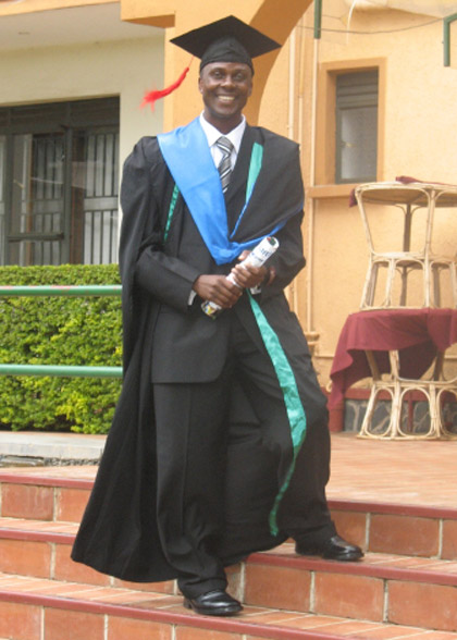 Allan Kisakye Graduating with his Social Work Degree