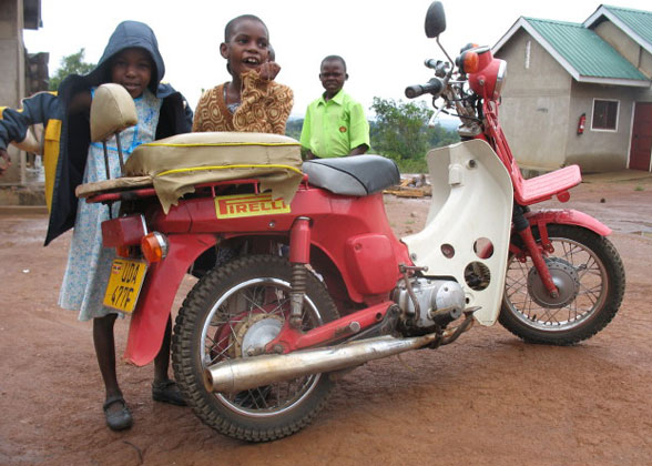 EWCV Children Admiring Donated Motorcycle