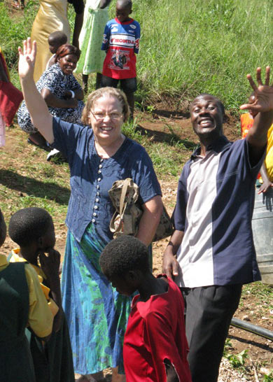 Ann and a Staff Member Smiling and Waving at Well Water Celebration