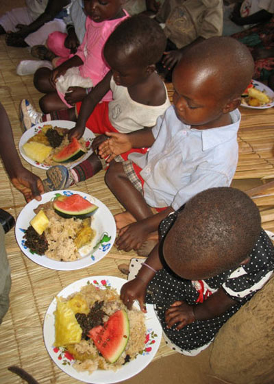 Children Enjoying Meal That Included Beef and Chicken