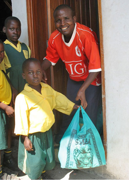 Boy Receiving Christmas Gift Bag