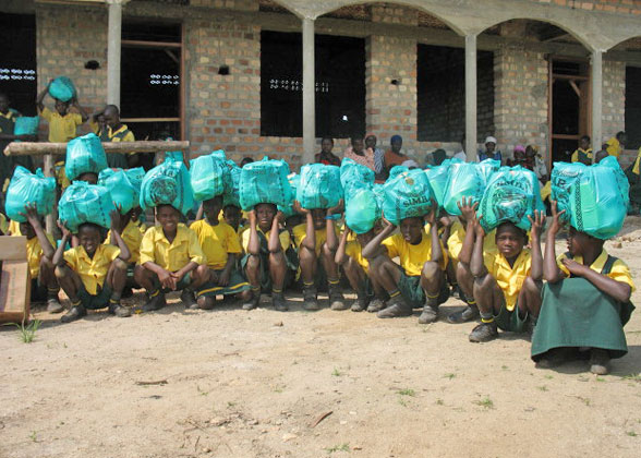 Students Posing with Christmas Gift Bags on their Heads