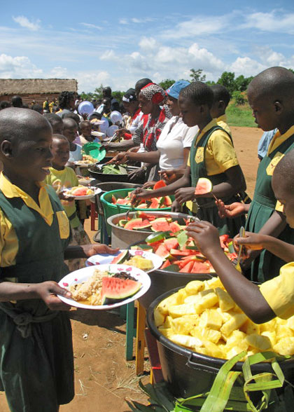 People Being Served Christmas Dinner after Church Service