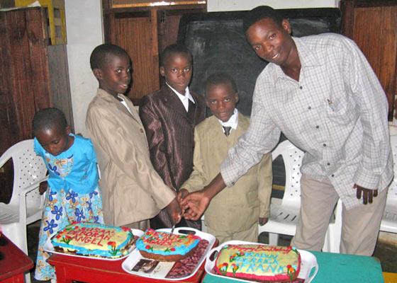 Three EWCV boys and one male staff member cut their birthday cakes.