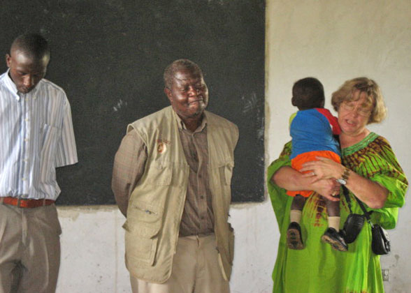 Ja Ja Ann Praying, Rev. Christopher Translating, at First School Assembly