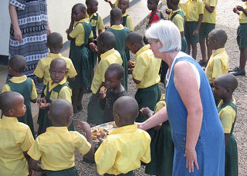 Sharon Serving Cake to EWCV Children
