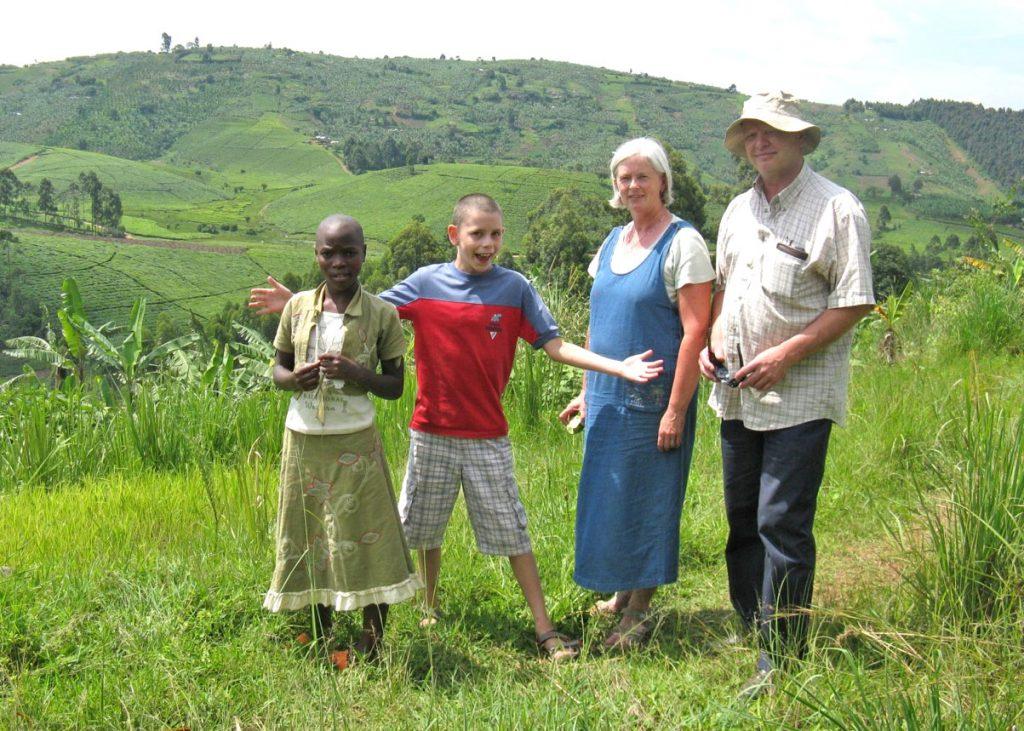 Visitors and Sponsored Child Enjoying Ugandan Countryside
