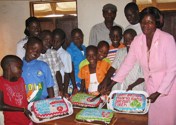 Children and Staff with Birthday Cakes