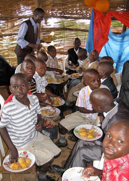 Family Children Enjoying Meal on Jesus's Birthday