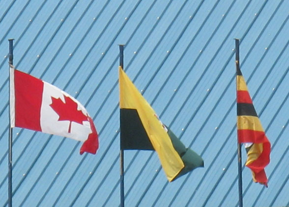 Three Flags: Canadian Flag, School Flag, Ugandan Flag