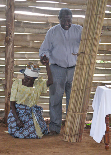Rev. Muwonge and Donor with New Bamboo Church Mat