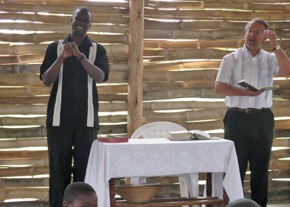 Dr. Macris Preaching, Allan Kisakye Translating into Uganda