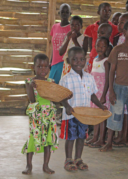 Elisha and Friend Passing the Offering Baskets at Church