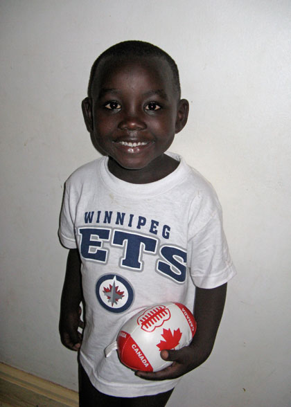 Elisha, Youngest EWCV Child, in Winnipeg Jets Shirt