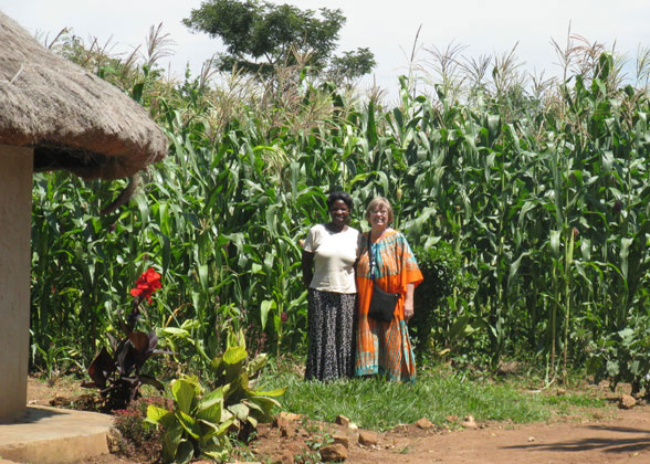 Maama Sarah and Ja Ja Ann in front of Tall Maize Crop