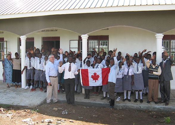 C4A Presenters Giving Canada Flag to EWCV High School Students