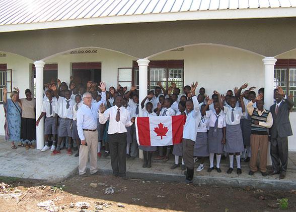 C4A Presenters Giving Canada Flag to EWCV High School Students
