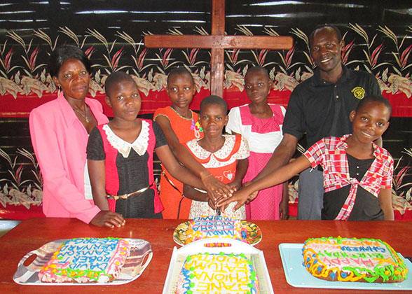 Children with Birthday Cakes