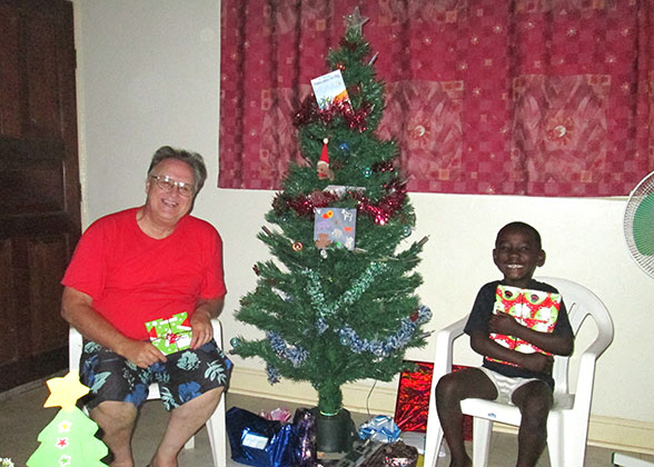 Bill and Elisha with Christmas Gifts