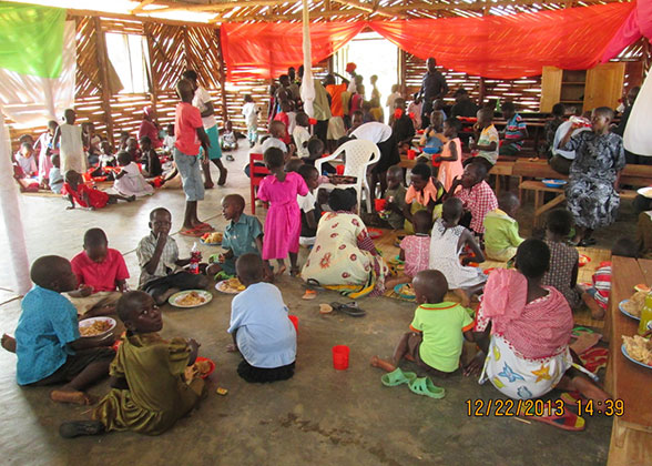 EWCV Children and People from the Neighbouring Community Eating the Christmas Meal