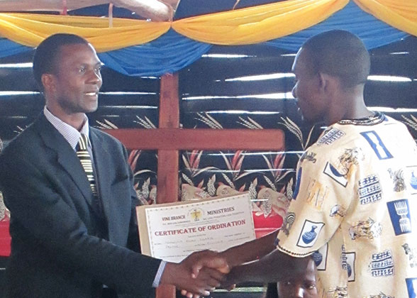 Allan Receiving his Ordination Certificate