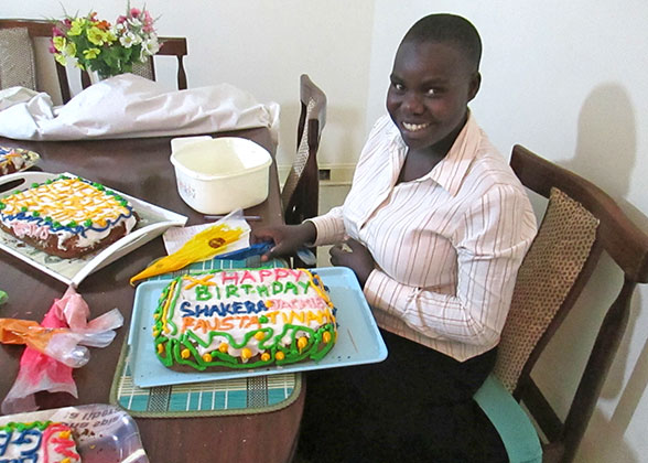 Senior Four Student with Birthday Cake