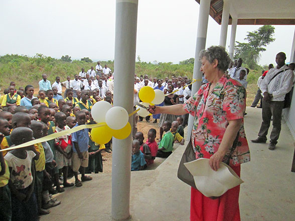 Sophia Cutting the Ribbon to the Two School Kitchens