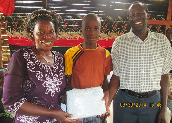 House Parents give a birthday present to an EWCV child.