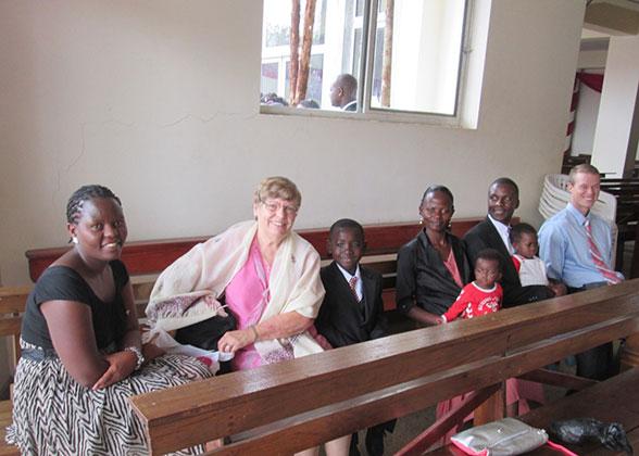 Rachael, Ann, the Kisakye Family, and Volunteer Jonathan