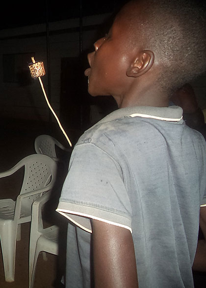 Child Blowing on Roasted Marshmallow