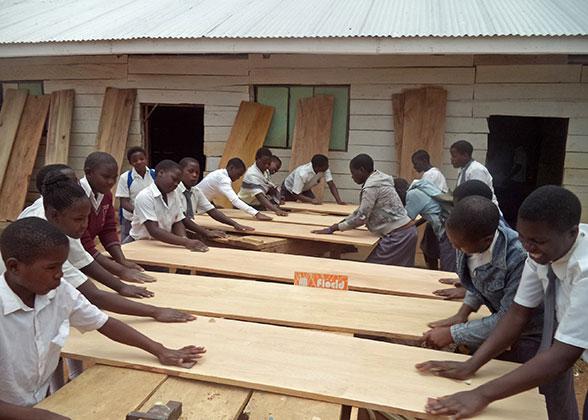 Students Sanding the Panels