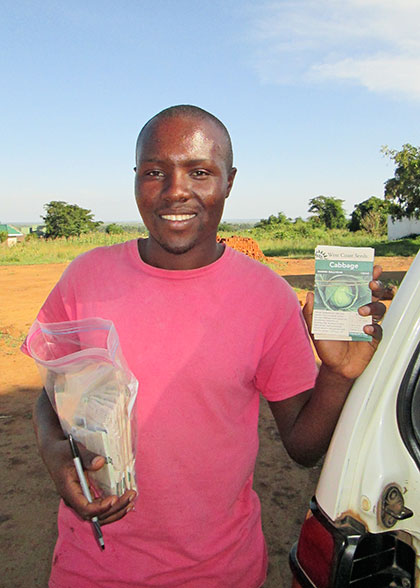An EWCV Staff Member Holding Donated Seeds