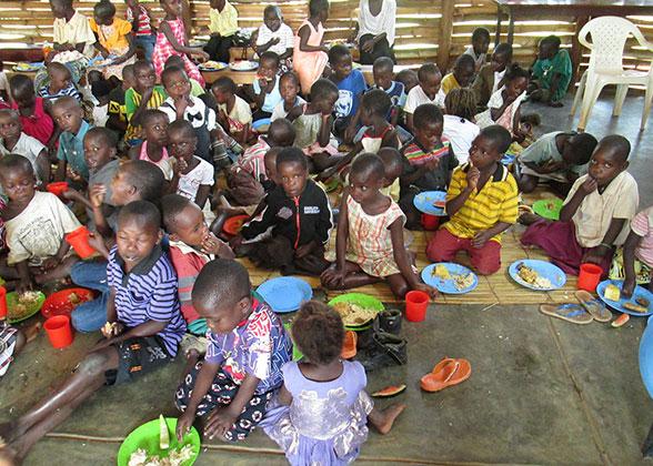 Children Enjoying Christmas Meal