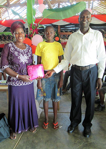 Boy with Birthday Gift and House Parents