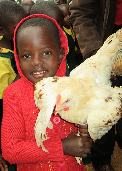 Another Happy Child with Chicken