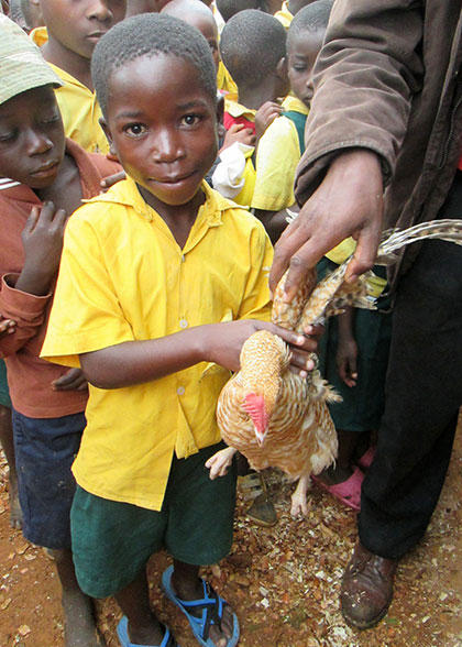 Smiling Child with Chicken