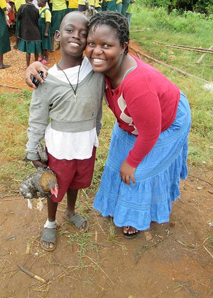 Rachael, Human Resource Manager, gives child a Christmas hug.