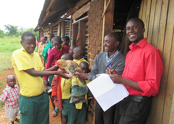 Chickens Being Handed Out to Children