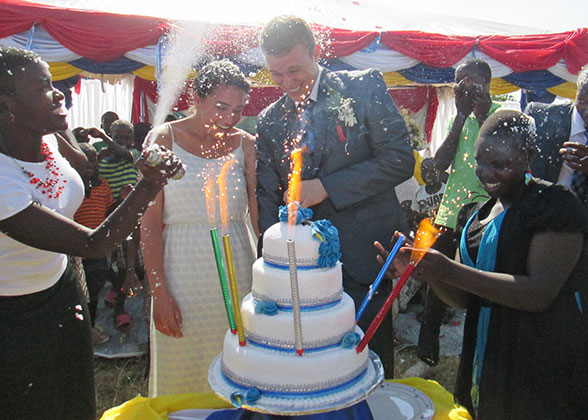 Jonathan and Alannah with Sparkling Wedding Cake