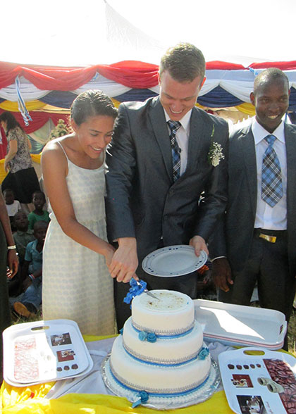 Jonathan and Alannah Cutting the Wedding Cake