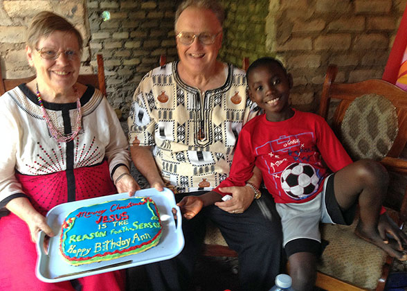 Bill and Ann and Elisha with a Merry Christmas Cake