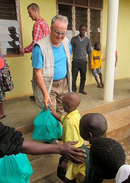 Ja Ja Bill Giving Christmas Gift Bag to EWCV Child