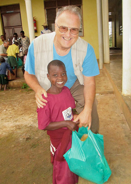 Ja Ja Bill and child with Christmas Gift Bags are all smiles.