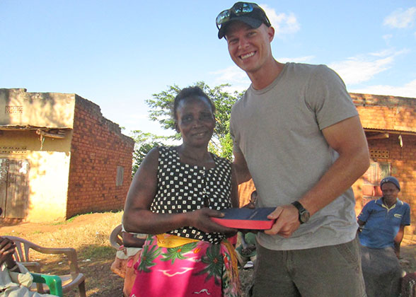 Village Woman Receiving Gideon Bible from Jonathan