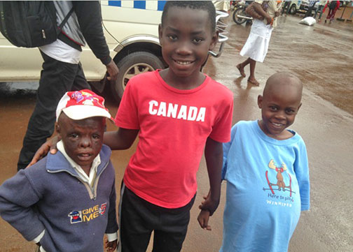 Samuel, Elisha, and Reagan in Kampala